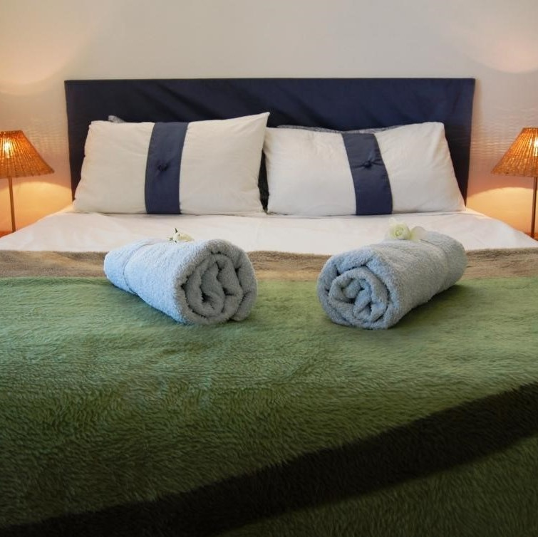 Dreams Hoiday accommodation with queen bed and balcony